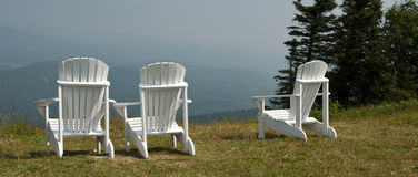 White lawn chairs with a view awaiting someone Royalty Free Stock Photos