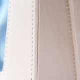 White leather bag. White leather from a fashionable bag in close up Royalty Free Stock Photography