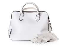 White leather bag and gloves Royalty Free Stock Photos