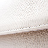 White leather. From a fashionable bag in close up Royalty Free Stock Photography