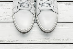 White leather gumshoes Stock Photography