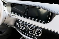 White leather interior of the luxury modern car. Leather comfortable white. multimedia. Steering wheel and dashboard. Automatic gear stick. Modern car interior Stock Image