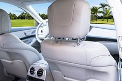 White leather interior of the luxury modern car. Leather comfortable white seats and multimedia. Steering wheel and dashboard. Automatic gear shift. Car Stock Image