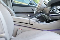 White leather interior of the luxury modern car. Leather comfortable white seats and multimedia. Steering wheel and dashboard. Automatic gear shift. Car Stock Photography