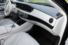 White leather interior of the luxury modern car. Leather comfortable white seats and multimedia. Steering wheel and dashboard. Stock Image