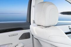 White leather interior of the luxury modern car. Leather comfortable white seats and multimedia. Steering wheel and dashboard. Automatic gear stick. Car Royalty Free Stock Photos