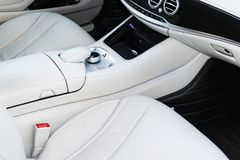 White leather interior of the luxury modern car. Leather comfortable white seats and multimedia. Steering wheel and dashboard. Stock Photography