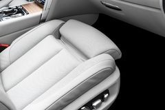 White leather interior of the luxury modern car. Perforated white leather comfortable seats with stitching. Modern car interior d. Etails. Car detailing. Car royalty free stock photography