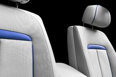 White leather interior of the luxury modern car. Perforated white leather comfortable seats with stitching isolated on black backg. Round. Modern car interior stock photos