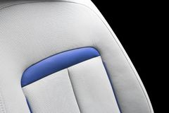 White leather interior of the luxury modern car. Perforated white leather comfortable seats with stitching isolated on black backg. Round. Modern car interior stock photo