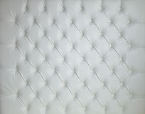 WHITE LEATHER PADDED STUDDED LUXURY BACKGROUND Stock Photo