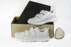 White Leather Shoes. And shoebox on a white background Stock Image