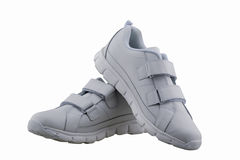 White Leather Shoes. White leather sport shoes unisex isolate Royalty Free Stock Images