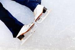 White leather skates on ice Royalty Free Stock Photo