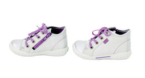 White leather sneakers with purple shoelace. Stock Image