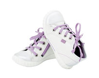White leather sneakers with purple shoelace. Royalty Free Stock Images