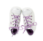 White leather sneakers with purple shoelace. Stock Photography