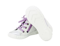 White leather sneakers with purple shoelace. Stock Photos