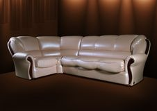 White leather sofa on a brown background. White elegant leather sofa on a brown background Royalty Free Stock Photography