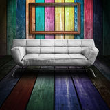 White leather sofa in Colorful Wood Room Stock Photo