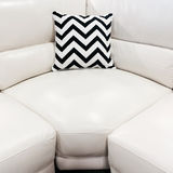 White leather sofa with decorative cushion Royalty Free Stock Image