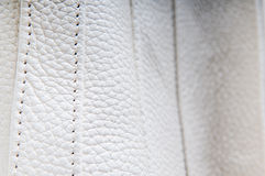 White leather stitches. White leather from a fashionable bag in close up Stock Photos