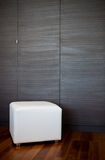 White leather stool. In the room Royalty Free Stock Photos
