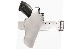 White leather two prong belt with a gun in a molded holster, clo Stock Images