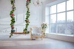 White Leather Vintage Style Chair In Classical Interior Room With Big Window And Spring Flowers Royalty Free Stock Images