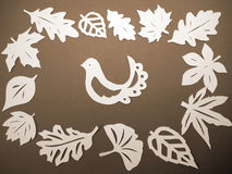 White leaves and bird. Paper cutting. Royalty Free Stock Images