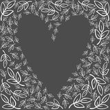 White leaves heart shape on dark Stock Photography