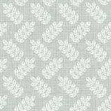 White leaves on patterned blue Royalty Free Stock Image