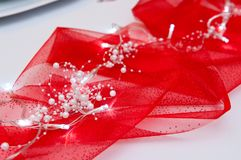 Led lights on red drapery as Christmas table decoration. White led lights arranged on red drapery or cloth as Christmas table decoration stock images