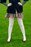White Legs Against Green Grass Stock Photo