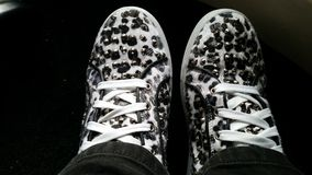 White leopard print sneakers. Designer looking sneakers trainers Royalty Free Stock Image