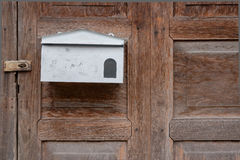 White Letterbox on Old Wood Royalty Free Stock Photography