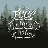 White lettering feel the breath of nature on fir tree card Stock Photos
