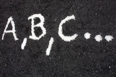 White letters a, b, c, written on the floor Royalty Free Stock Photos