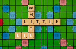 White Lie. Little white lie spelled out on scrabble board royalty free stock photos