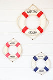 White Life buoy with welcome aboard on white wall Royalty Free Stock Photography