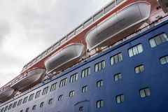 White lifeboats on a luxury blue cruise ship Royalty Free Stock Photos