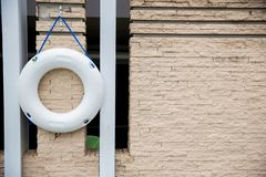 White lifebuoy,All Water rescue emergency equipment. white ifebuoy on wall near swimming pool. White lifebuoy,All Water rescue emergency equipment..white ifebuoy stock image