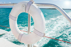 White Lifebuoy. Close up of a white lifebuoy on the railing of a sailboat in navigation Stock Images