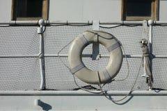 White Lifebuoy. A white lifebuoy tied to a ship Royalty Free Stock Image
