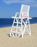 White lifeguard chair on empty sand beach with blue sky. With no people stock photography