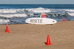 White Lifeguard Rescue Board Surrounded By Orange Cones Stock Photos