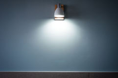 the White Light Beam from lamp on blue wallpaper background Royalty Free Stock Photography