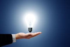 White light bulb in hand. Stock Images