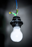 White light bulb hanging in the black cartridge Stock Photography