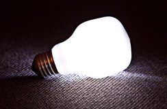White light bulb lamp illuminated in dark Stock Photo